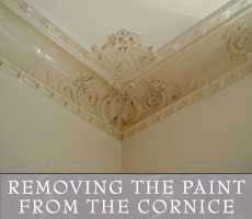 Removing the paint from the cornice